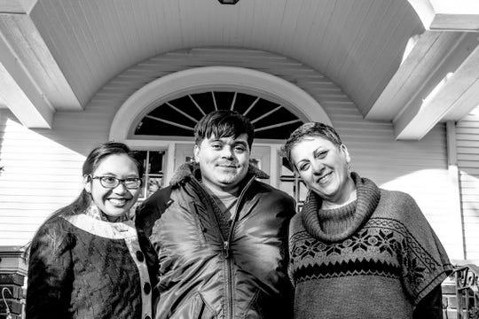 "Melissa Palma, Jesus ""Chuy"" Renteria and Sadagat Aliyeva are shown in front of the Iowa Writers' House. Photo by Miriam Alarcon Avila."