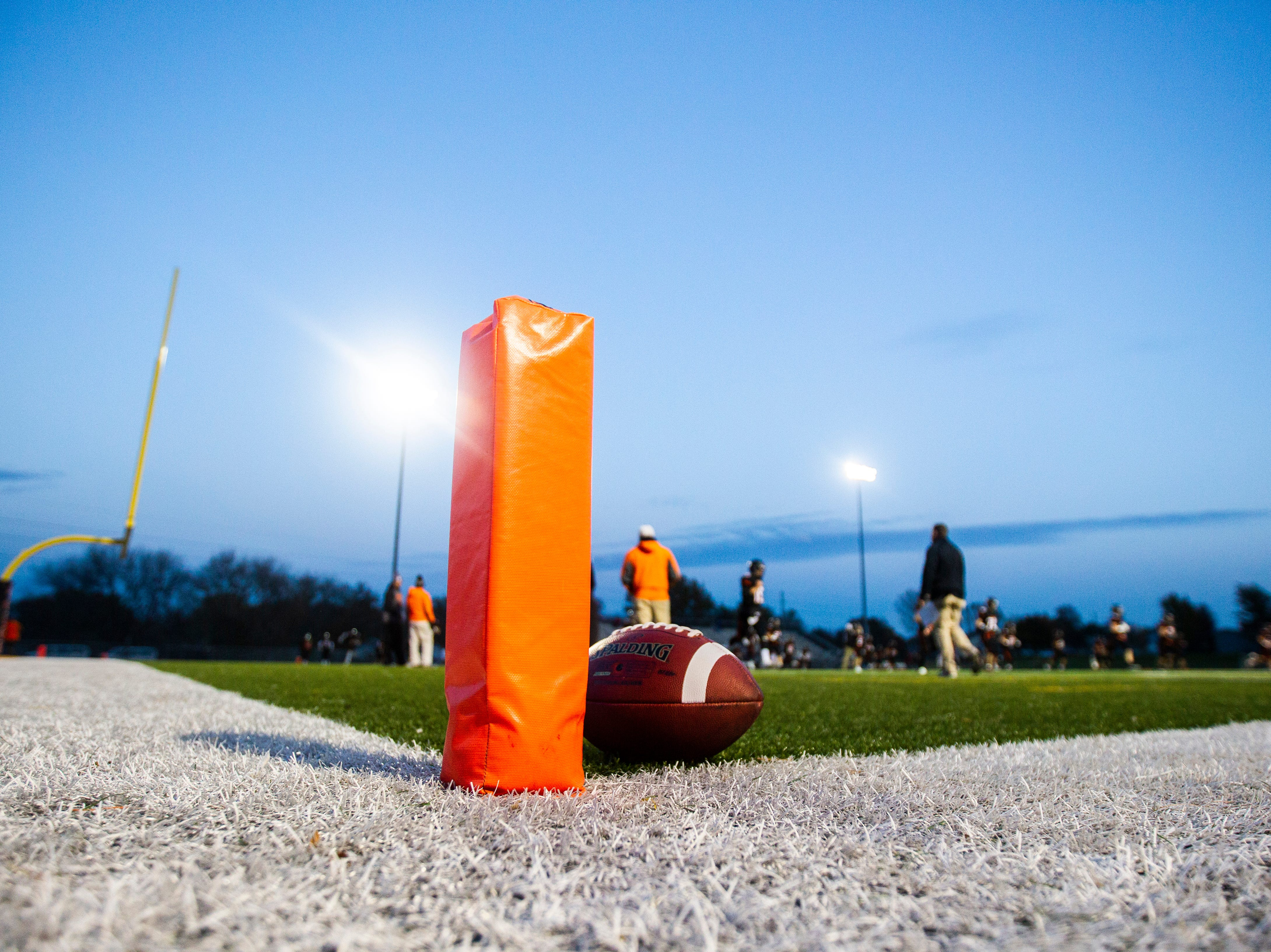 Solon players warm up before a Class 3A varsity first round playoff football game on Friday, Oct. 26, 2018, at Spartan Stadium in Solon, Iowa.