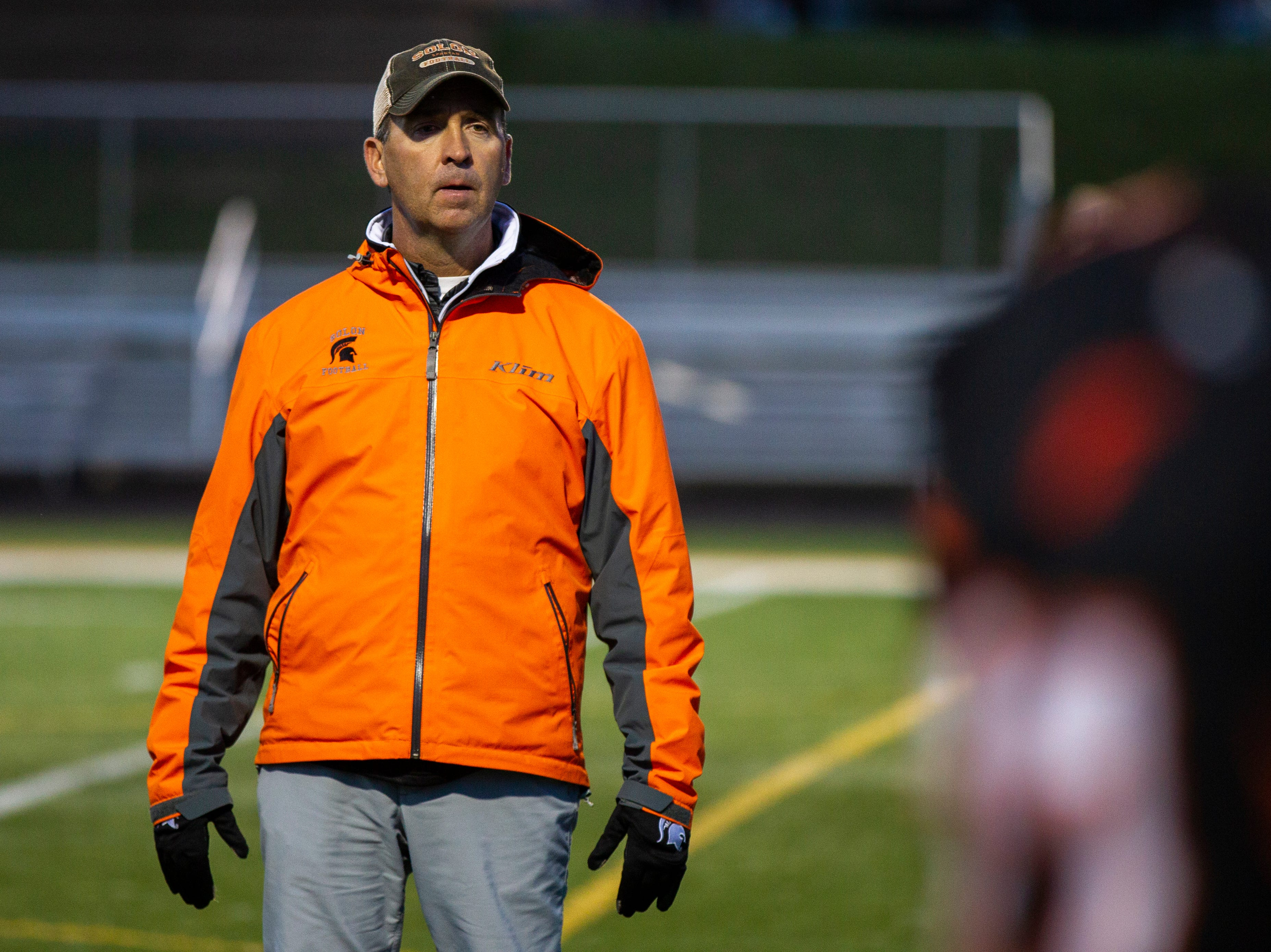 Solon football head coach Kevin Miller calls out to players before a Class 3A varsity first round playoff football game on Friday, Oct. 26, 2018, at Spartan Stadium in Solon, Iowa.