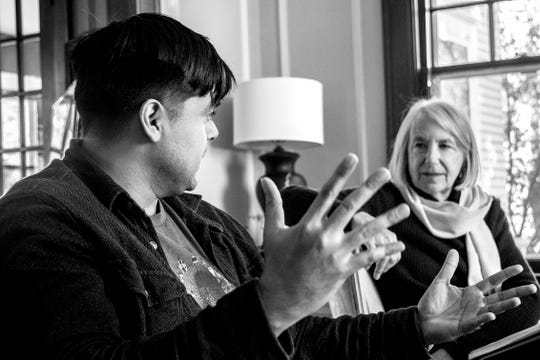 "Jesus ""Chuy"" Renteria and Maggie Conroy are shown inside the Iowa Writers' House. Photo by Miriam Alarcon Avila."