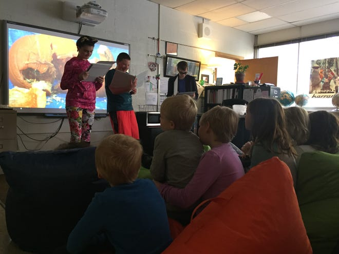 Students perform a short skit about a gardener desperate to avoid pumpkins at the Fall Festival hosted by the Iowa City Home School Assistance Program.