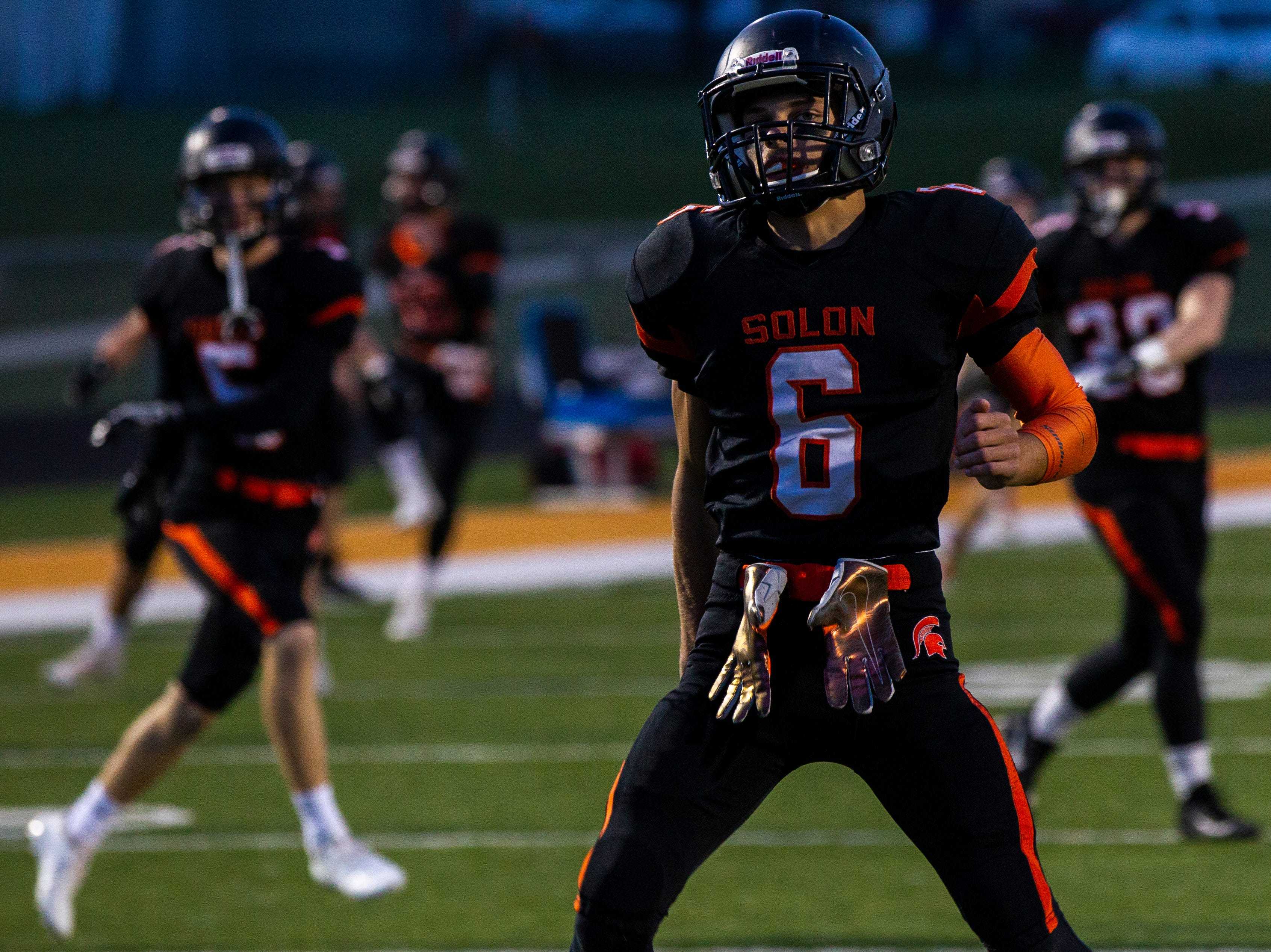 Solon's Dillon Holt (6) warms up before a Class 3A varsity first round playoff football game on Friday, Oct. 26, 2018, at Spartan Stadium in Solon, Iowa.