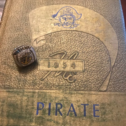 Pearl presented public address announcer Ray Rogers with a state championship ring after the Pirates won the 6A championship in 2017. Pearl had never won a state title.