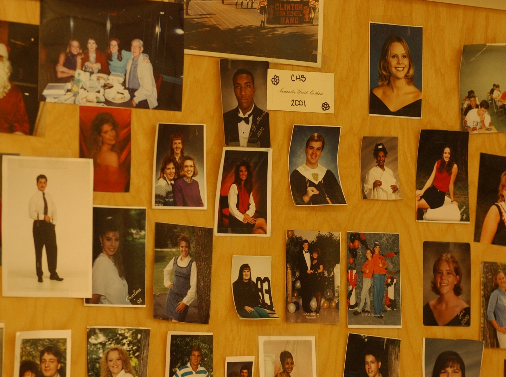 "A wall of photographs of current and former students of Elizabeth Cobb a Clinton High School Teacher. For some 4.1 million ""leapers"" worldwide, the calendar gave as their birthright the gift of youth.  Take Elizabeth Cobb, for instance.  After four decades at Clinton High School, teaching psychology, sociology, and history, maybe she should start thinking about retiring. If she does, it would an interesting headline, guaranteed to leave people scratching their head: ""Teacher, Age 18, Retires After 40 Years of Service"" ."