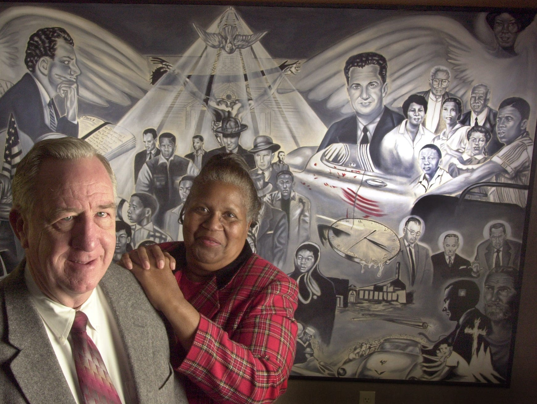 "Jerry Shattuck, left, and Theresser Caswell experienced the desegregation of Clinton High School in 1956 in  two very different ways.  Shattuck was a senior, Caswell was a freshman and both describe the situation at that time as very tense.  ""A walk of faith,"" is a painting by Rev. Alan Jones depicting the events during that period of change.  News Sentinel Photo by Joe Howell"