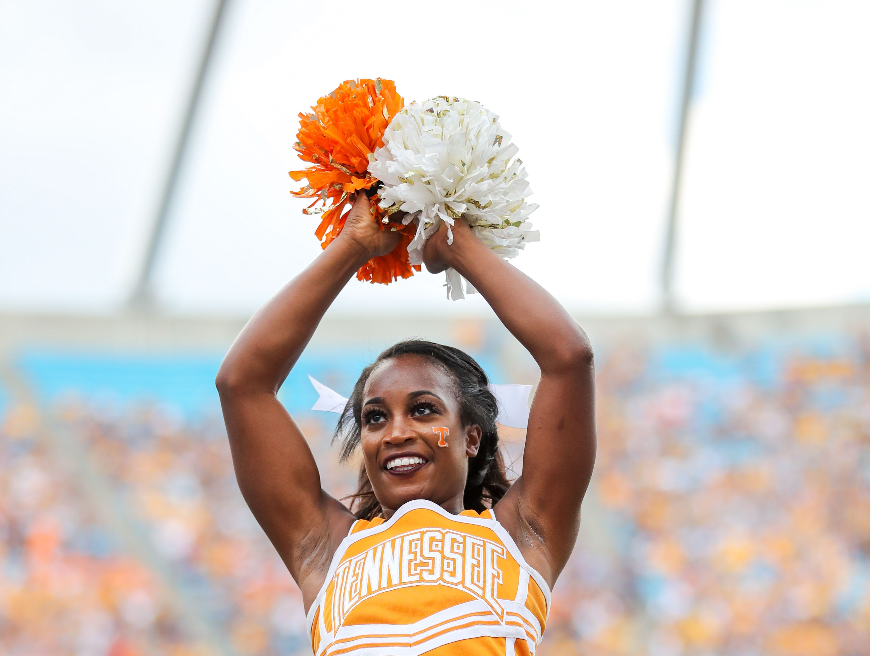 Sep 1, 2018; Charlotte, NC, USA; A Tennessee Volunteers cheerleader performs during the second quarter against the West Virginia Mountaineers at Bank of America Stadium.