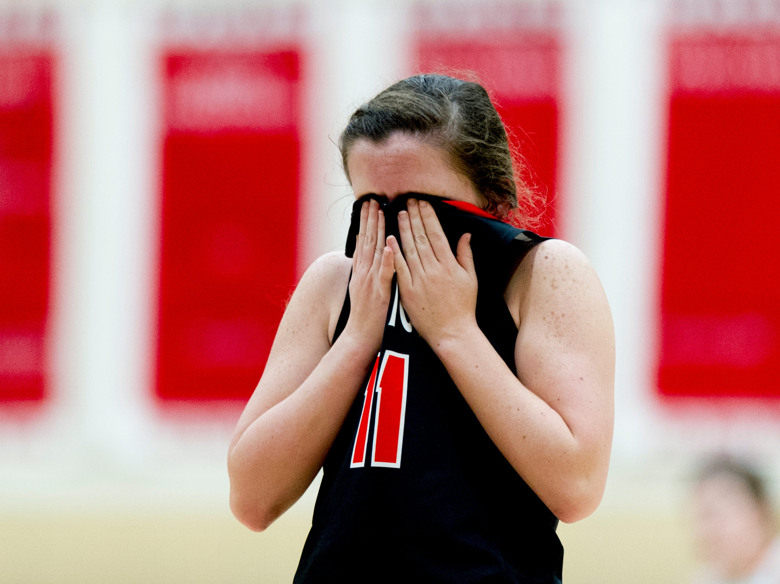 Clinton's Danyel Joy (11) wipes her eyes during a District 3AAA semifinals game between Campbell County and Clinton at Halls High School in Halls, Tennessee on Friday, February 16, 2018.
