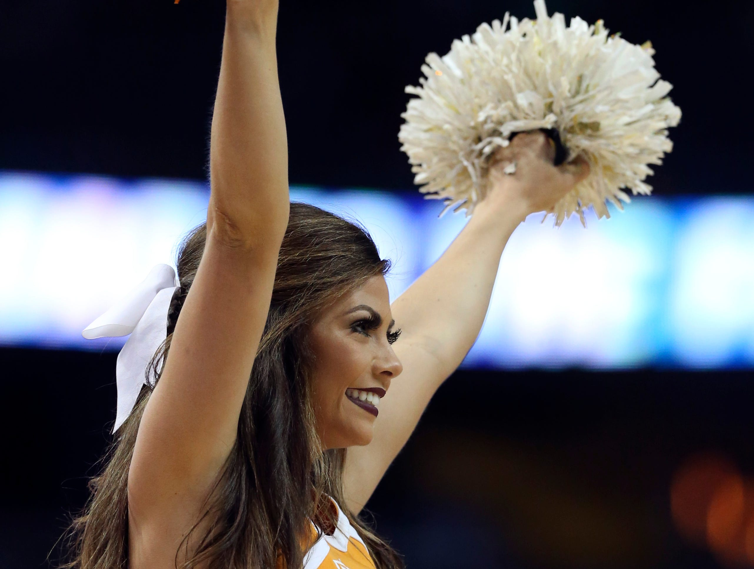 Mar 17, 2018; Dallas, TX, USA; Tennessee Volunteers cheerleader performs during the first half against the Loyola (Il) Ramblers in the second round of the 2018 NCAA Tournament at American Airlines Center.