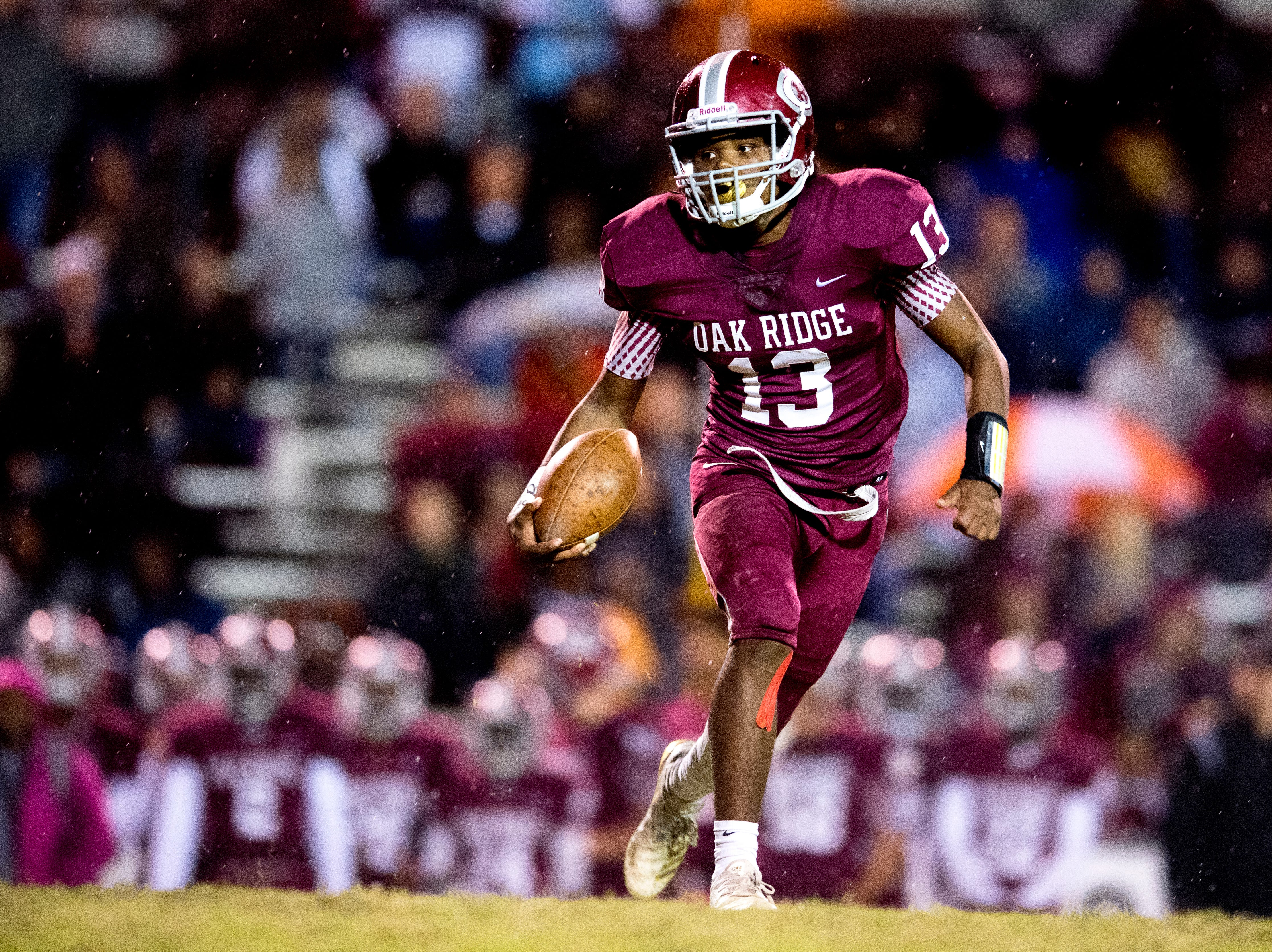 Oak Ridge's Herbert Booker (13) runs with the ball down the field during a football game between Oak Ridge and Fulton at Blankenship Field in Oak Ridge, Tennessee on Thursday, October 25, 2018.
