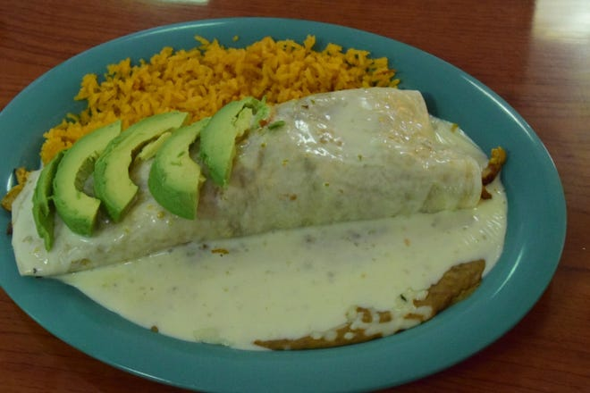 Hot and spicy burrito served up with steak, beans, lettuce, sour cream, pico de gallo, guacamole and rice at Country Burrito.