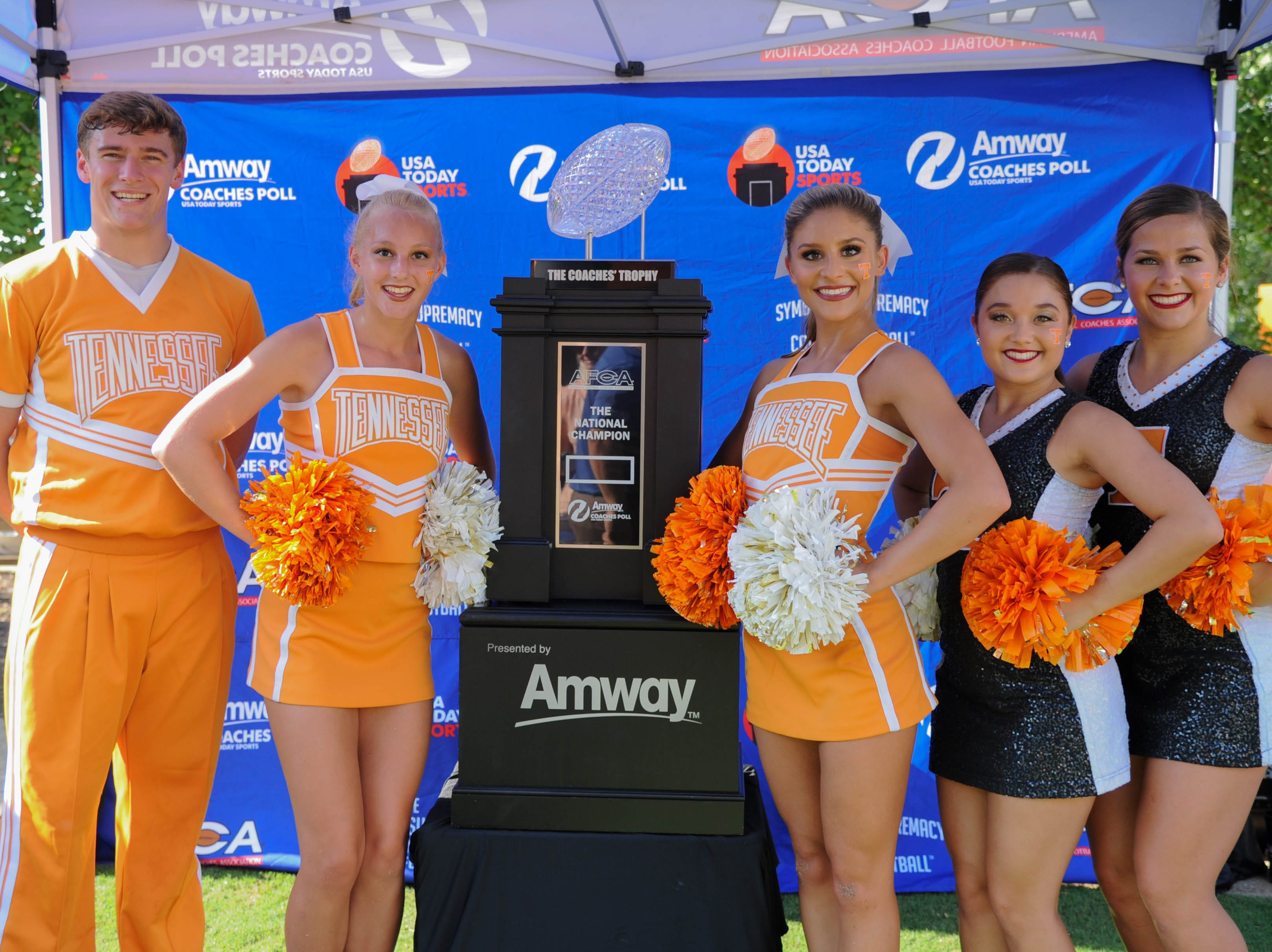 Sep 22, 2018; Knoxville, TN, USA; Tennessee Volunteers cheerleaders pose with the Amway Coaches Trophy before the game against the Florida Gators in Knoxville, TN.