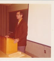 Robert McClung speaks at a Knoxville Gem and Mineral Society meeting at Brehm Hall on the University of Tennessee's agricultural campus. McClung and his wife served as presidents of the society at different times.