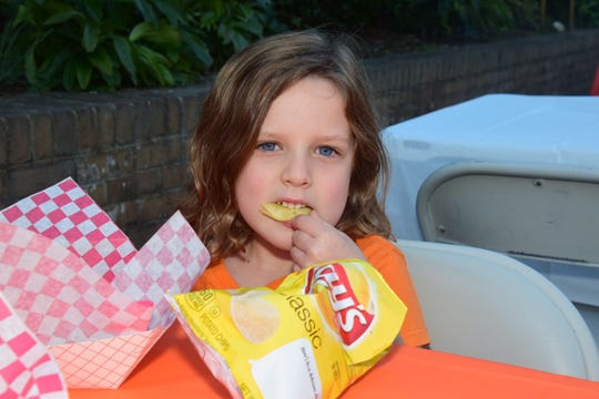 Elia Stamp, 5, seems to have found her bliss in a bag of Lay's potato chips.