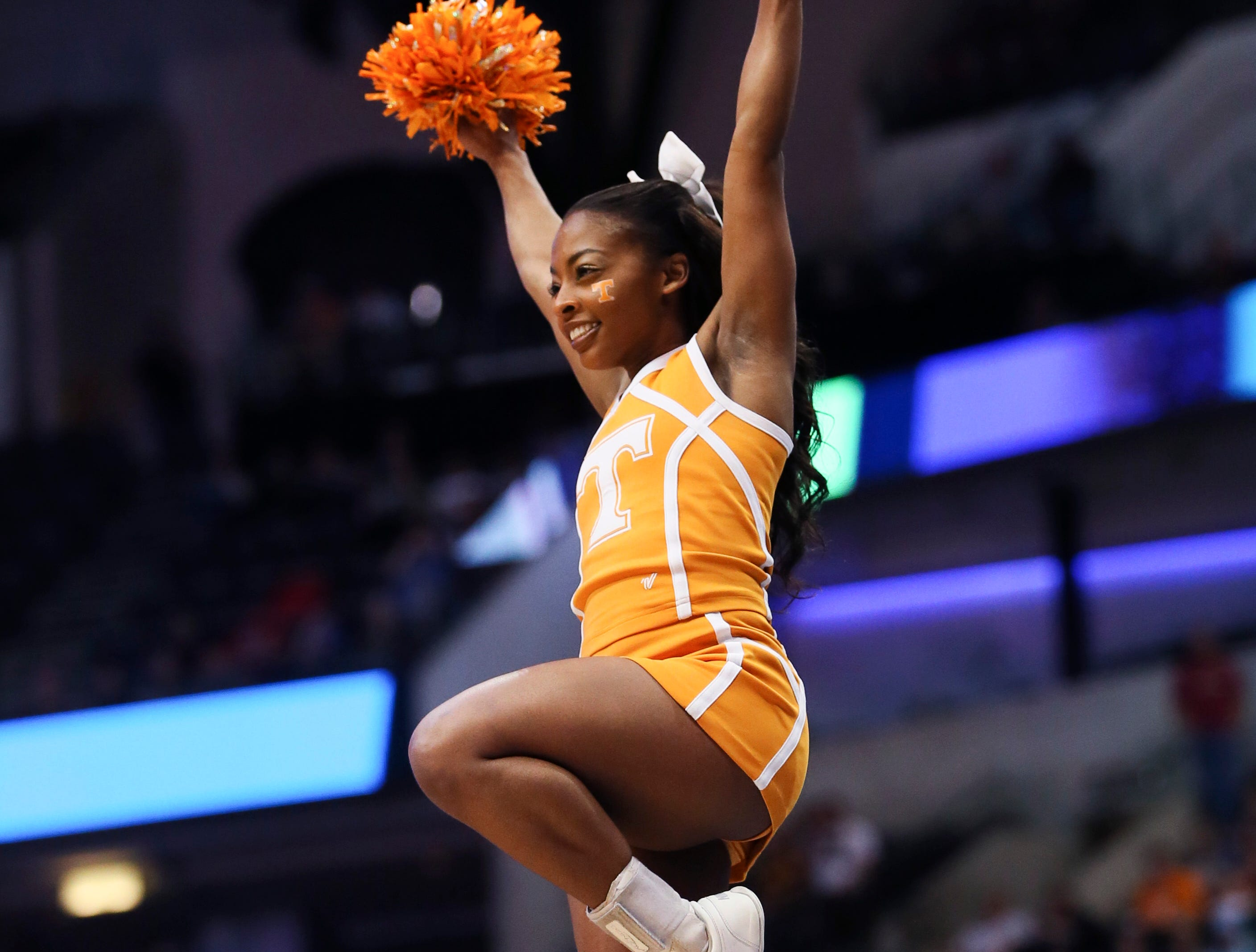 Mar 17, 2018; Dallas, TX, USA; Tennessee Volunteers cheerleader performs before the game against the Loyola (Il) Ramblers in the second round of the 2018 NCAA Tournament at American Airlines Center.