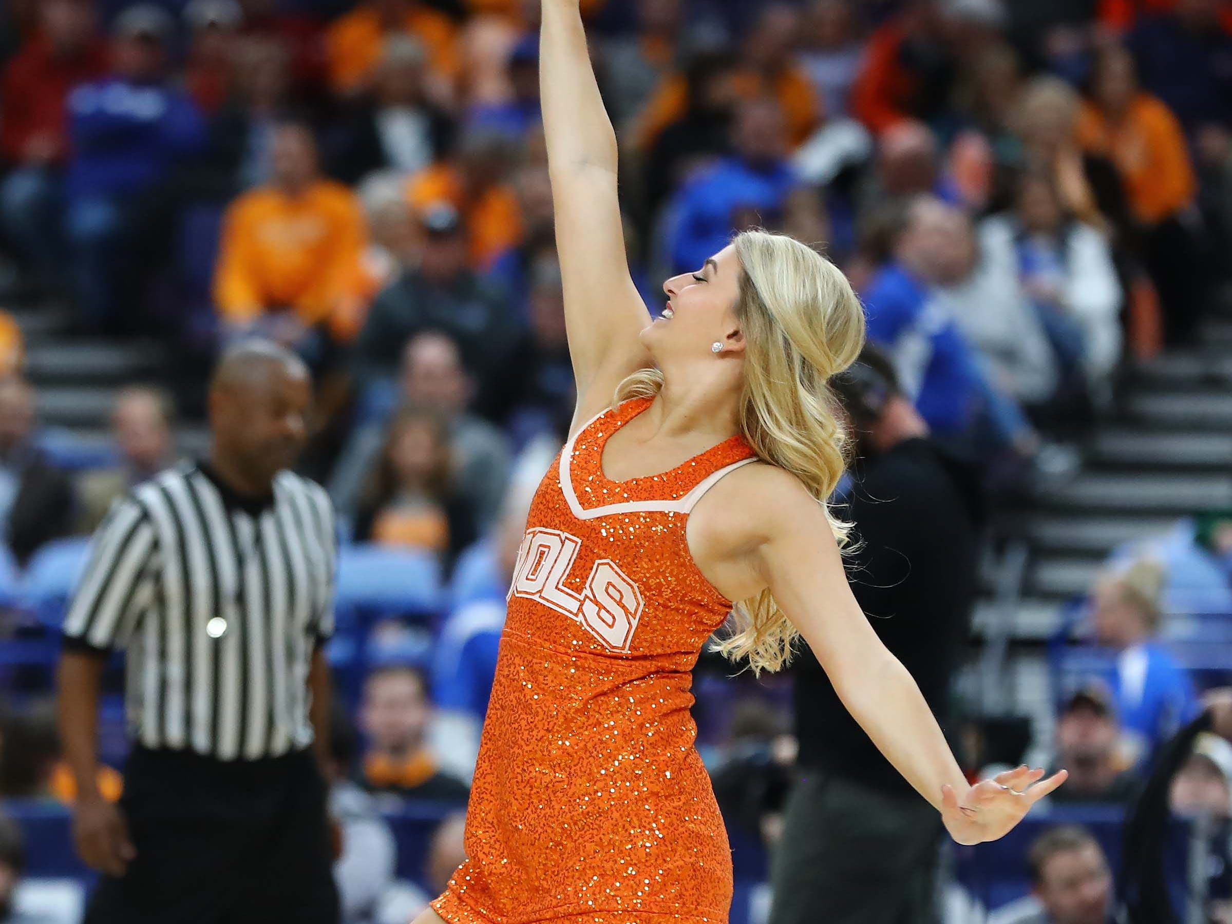 Mar 9, 2018; St. Louis, MO, USA; A member of the Tennessee Volunteers dance team performs during the first half of the quarterfinals of the SEC Conference Tournament against the Mississippi State Bulldogs at Scottrade Center.