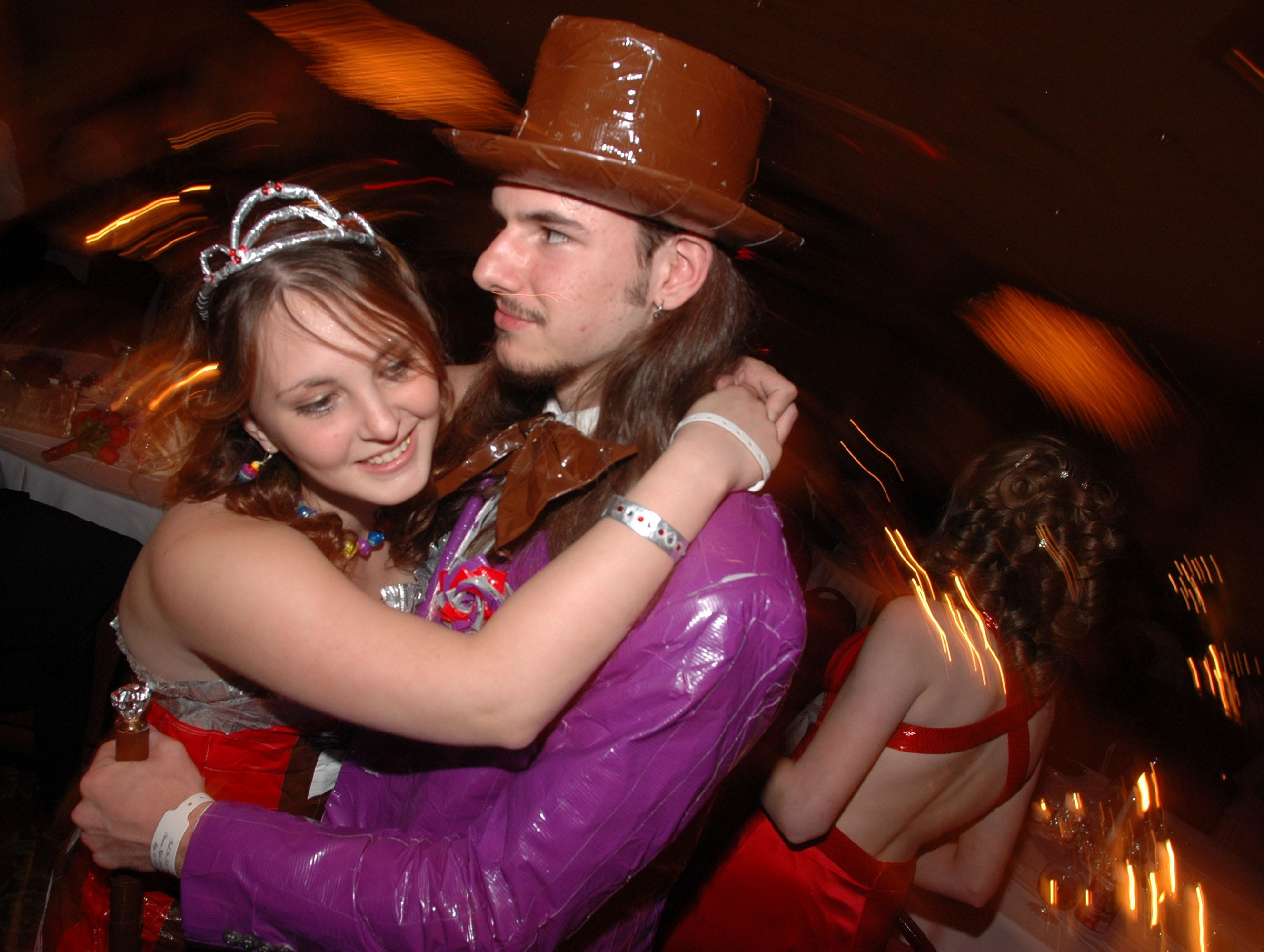 Krystle Gutman, left, gives her boyfriend T.J. Daugherty a hug inside the ballroom where the Clinton High School Prom was held Saturday night at the Crowne Plaza in Knoxville, Tenn. Gutman and Daugherty made their outfits using different color duck tape made to resemble the original Willy Wonka and the Chocolate Factory characters. 05/13/2006.