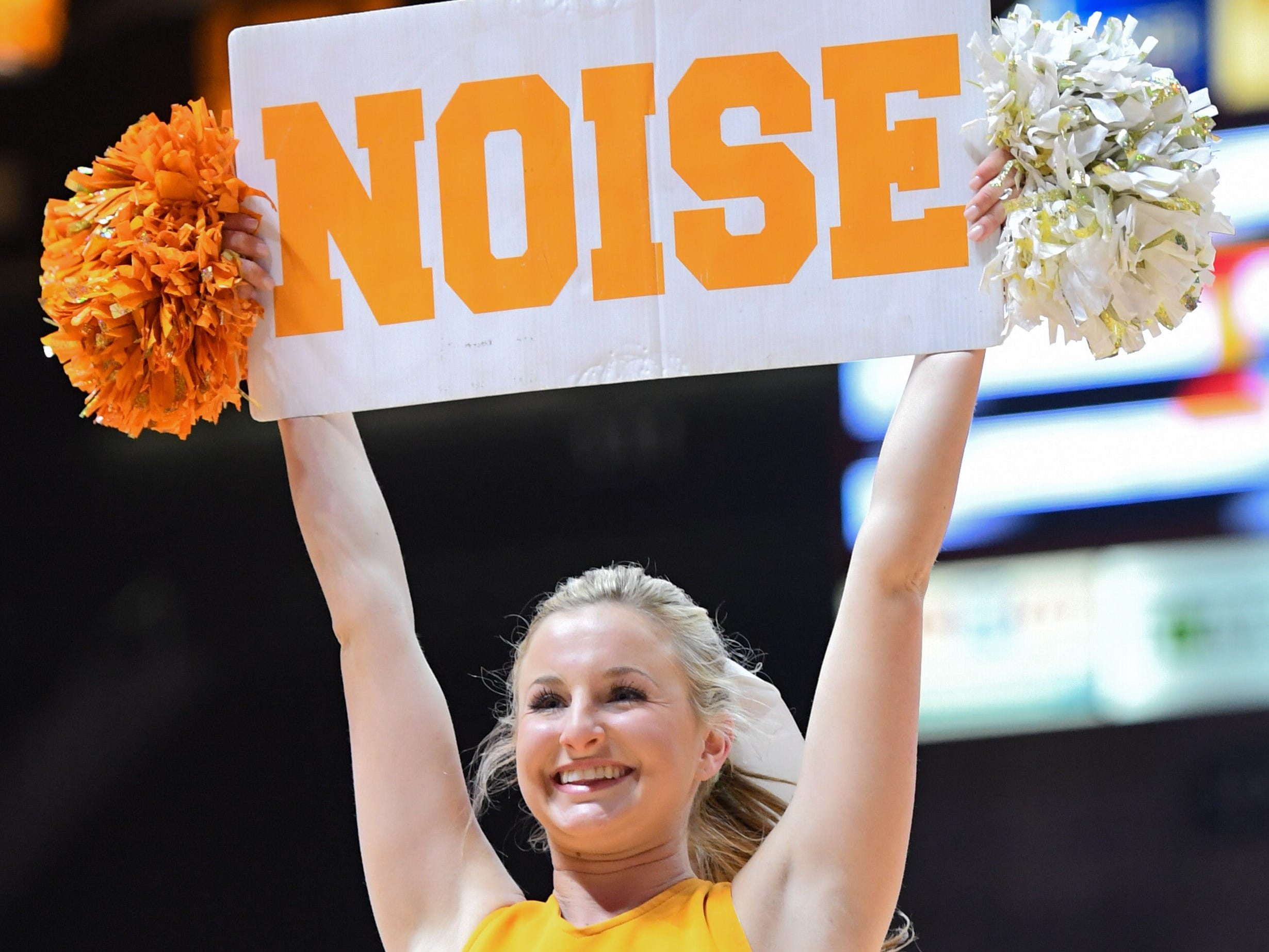 Jan 2, 2018; Knoxville, TN, USA; A Tennessee Volunteers cheerleader performs during a time out in the first half of the game against the Auburn Tigers  at Thompson-Boling Arena.