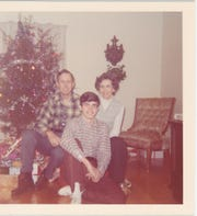 Robert, Frances and Craig McClung pose for a family photo at a relative's house one Christmas when Craig was around high school age. He and his family traveled around the country hunting for rocks together until he started college.