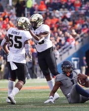 Purdue linebackers Derrick Barnes (55) and Cornel Jones celebrate a sack of Illinois quarterback AJ Bush Jr.