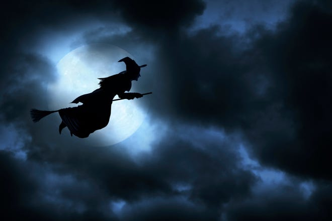 Witch flying on broom on spooky Halloween night.To see more of my Halloween images, click on the link below: