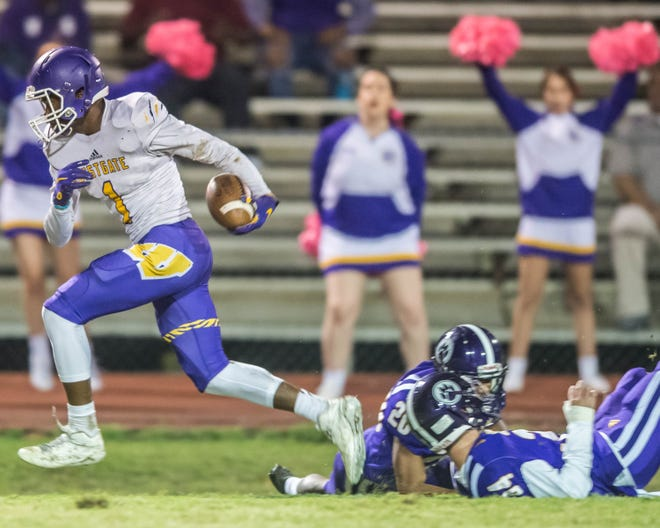 Kayshon Boutte (1) for the Westgate Tigers evades double coverage and looks to the end zone after making a reception Thursday night October 25, 2018.