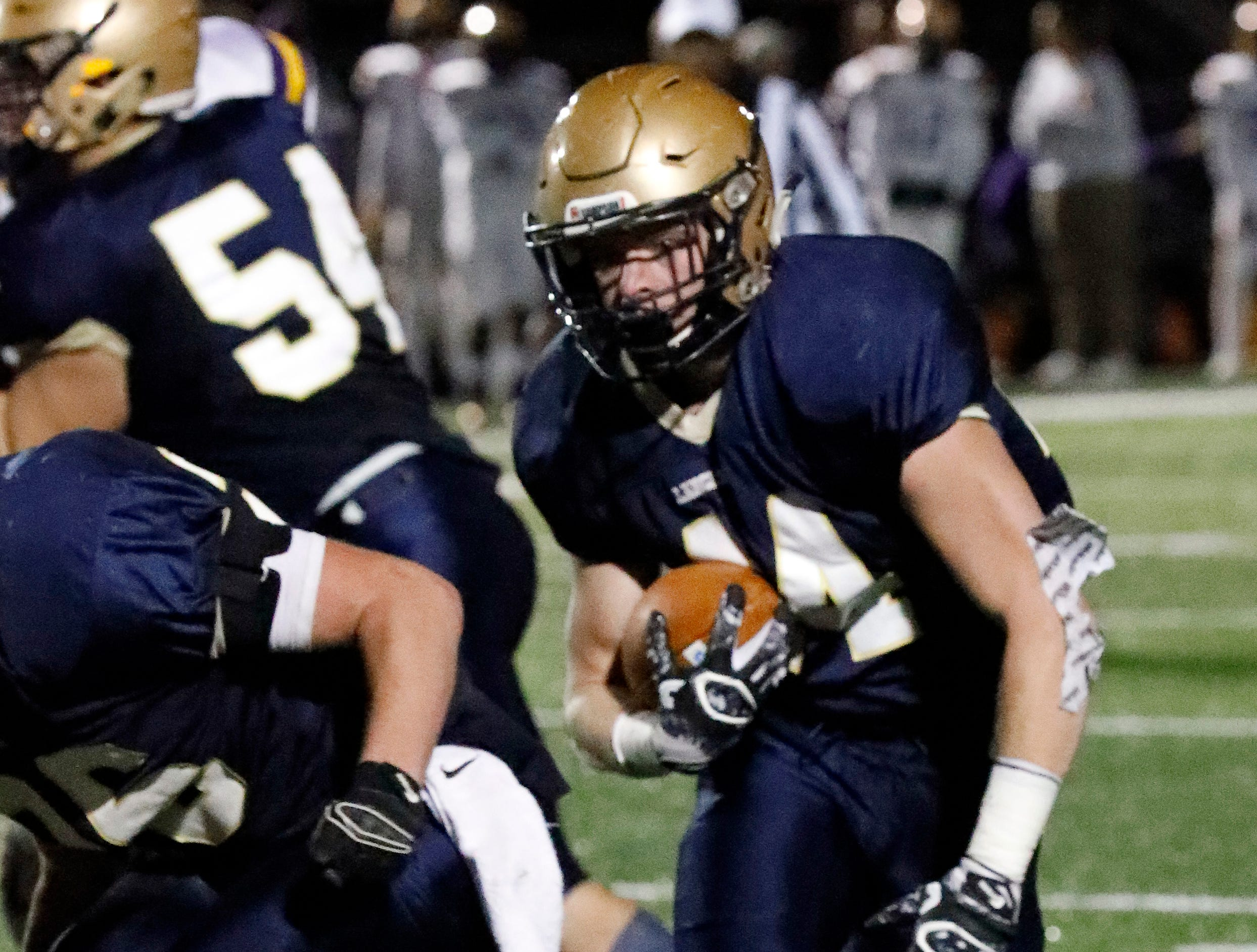 Lancaster's Alex Widener runs the ball during Thursday night's game, Oct. 25, 2018, against Reynoldsburg at Fulton Field in Lancaster. The Golden Gales lost the game 28-7.