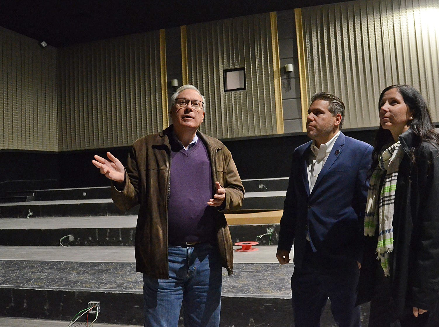 From left, Emagine Entertainment Chairman Paul Glantz, CEO Anthony LaVerde and Chief Marketing Officer Melissa Boudreau stand in a nearly completed theater at the soon-to-open Emagine Hartland movie theater, Friday, Oct. 26, 2018.
