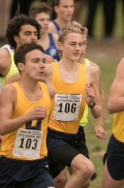 Hartland's Riley Hough (106) finished fourth in the regional cross country meet, lowering his Livingston County freshman record to 15:39.9.