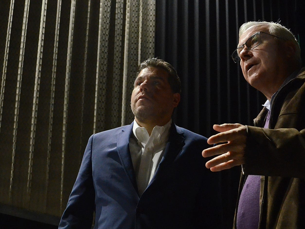 From left, Emagine Entertainment CEO Anthony LaVerde and Chairman Paul Glantz discuss the soon-to-be open Emagine Hartland movie theater in one of the nearly-finished screening rooms, Friday, Oct. 26, 2018.