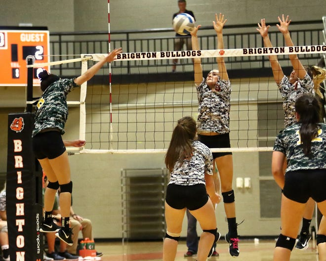 Howell (left) and Brighton are in the Division 1 volleyball district at Hartland, which begins Monday.