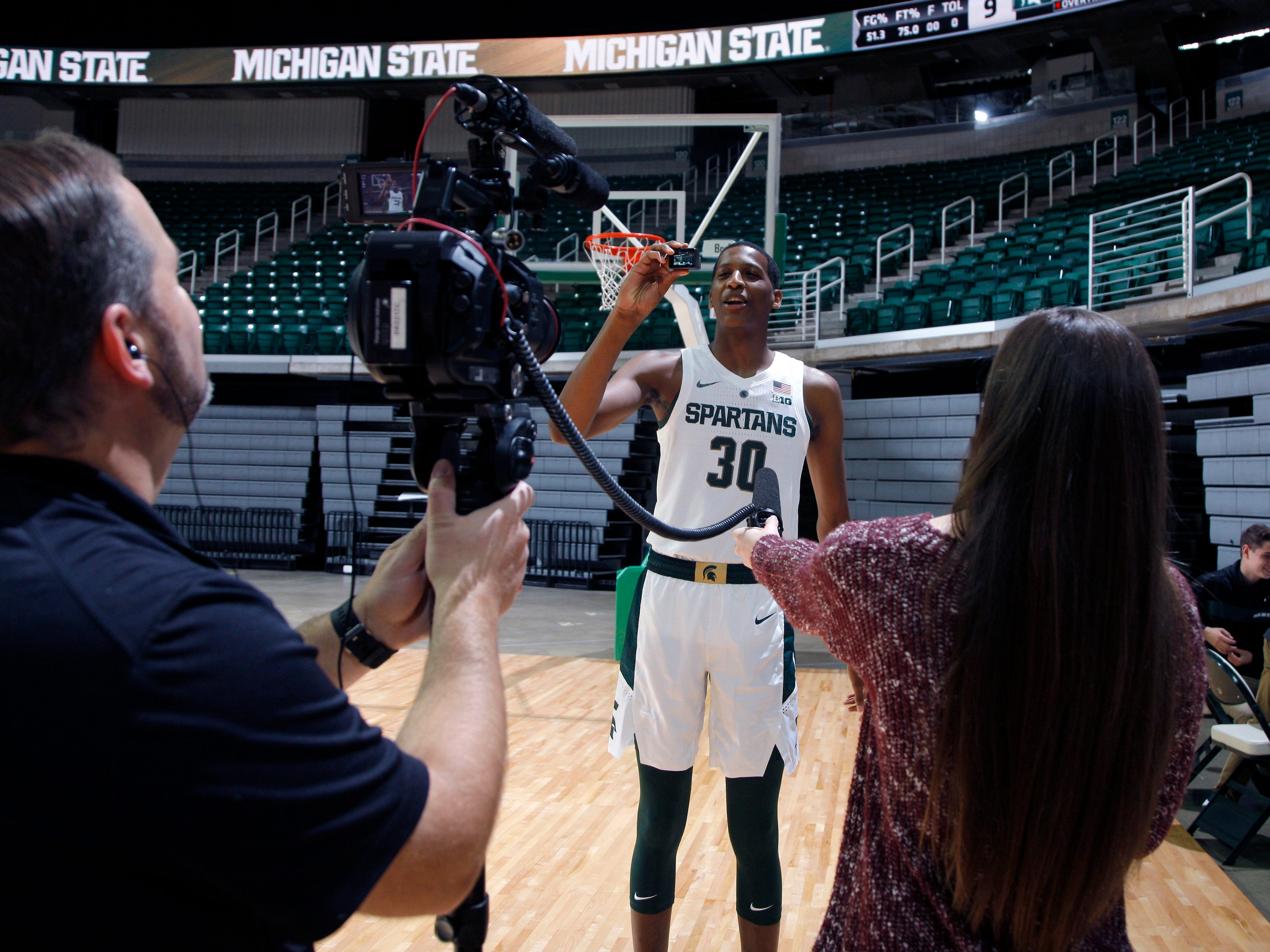 Michigan State freshman Marcus Bingham Jr. is interviewed during the team's media day, Thursday, Oct. 25, 2018, in East Lansing, Mich.