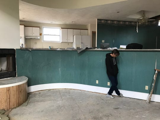 Michelle Maurer on the second-floor of the home her family has purchased on Billwood Highway in Dimondale Wednesday, Oct. 24, 2018. Abandoned for nearly a decade, and never finished the Maurer family aims to restore it.
