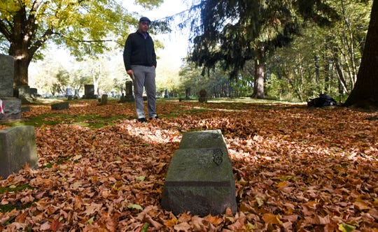 Benjamin Hall of Lansing stands in the area at Maple Grove Cemetery in Mason Oct. 24, 2018 where his great-great-great-grandmother Merry Willis is buried in an ummarked grave. Both Merry and her husband Thomas were slaves in Kentucky. Thomas bought his freedom at 28 and went to Canada to wait for Merry.  She escaped with her infant daughter years later and traveled the Underground Railroad to Canada to meet up with Thomas. They moved to Mason around the time of the Civil War. Ben believes they were some of the first black settlers in Ingham County. Both have unmarked graves in separate areas of Maple Grove Cemetery.  Hall is trying to raise funds to buy markers for the graves, to ensure they and their history are not forgotten.