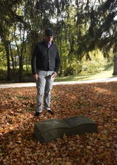 Benjamin Hall of Lansing stands in the area at Maple Grove Cemetery in Mason Oct. 24, 2018 where his great-great-great-grandmother Merry Willis is buried in an ummarked grave.