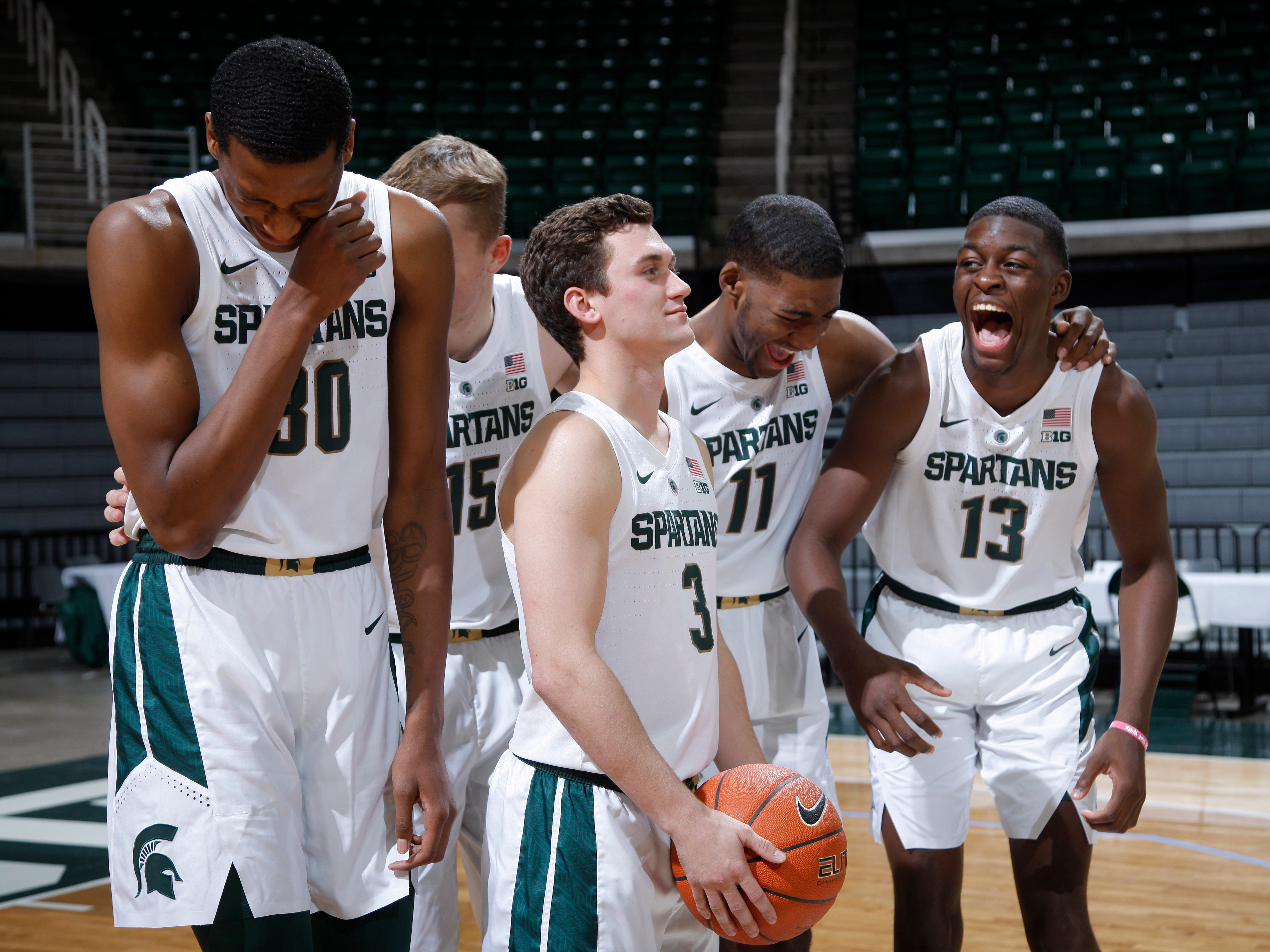 Michigan State freshmen from left, Marcus Bingham Jr., Thomas Kithier, Foster Loyer, Aaron Henry and Gabe Brown laugh while being photographed during the team's media day, Thursday, Oct. 25, 2018, in East Lansing, Mich.
