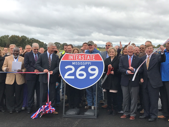 Mississippi officials cut the ribbon to signify the completion of Interstate 269 on Friday. The corridor is a half-loop stretching 60 miles along the outside of Memphis from the Hernando, Miss., area to Millington, Tenn.
