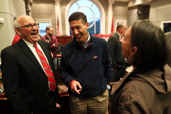 Congressman David Kustoff, center, shares a laugh with Collierville Mayor Stan Joyner,  Jr. during a campaign stop at the Collierville Town Hall on Friday, Oct. 26, 2018.