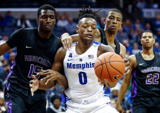 Memphis forward Kyvon Davenport (middle) battles for a rebound against the LeMoyne-Owen defense during action of their exhibition game at the FedExForum.