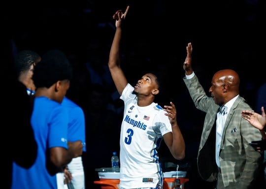 Memphis guard Jeremiah Martin (middle) is introduced during player introductions before taking on LeMoyne-Owen in a exhibition game at the FedExForum.