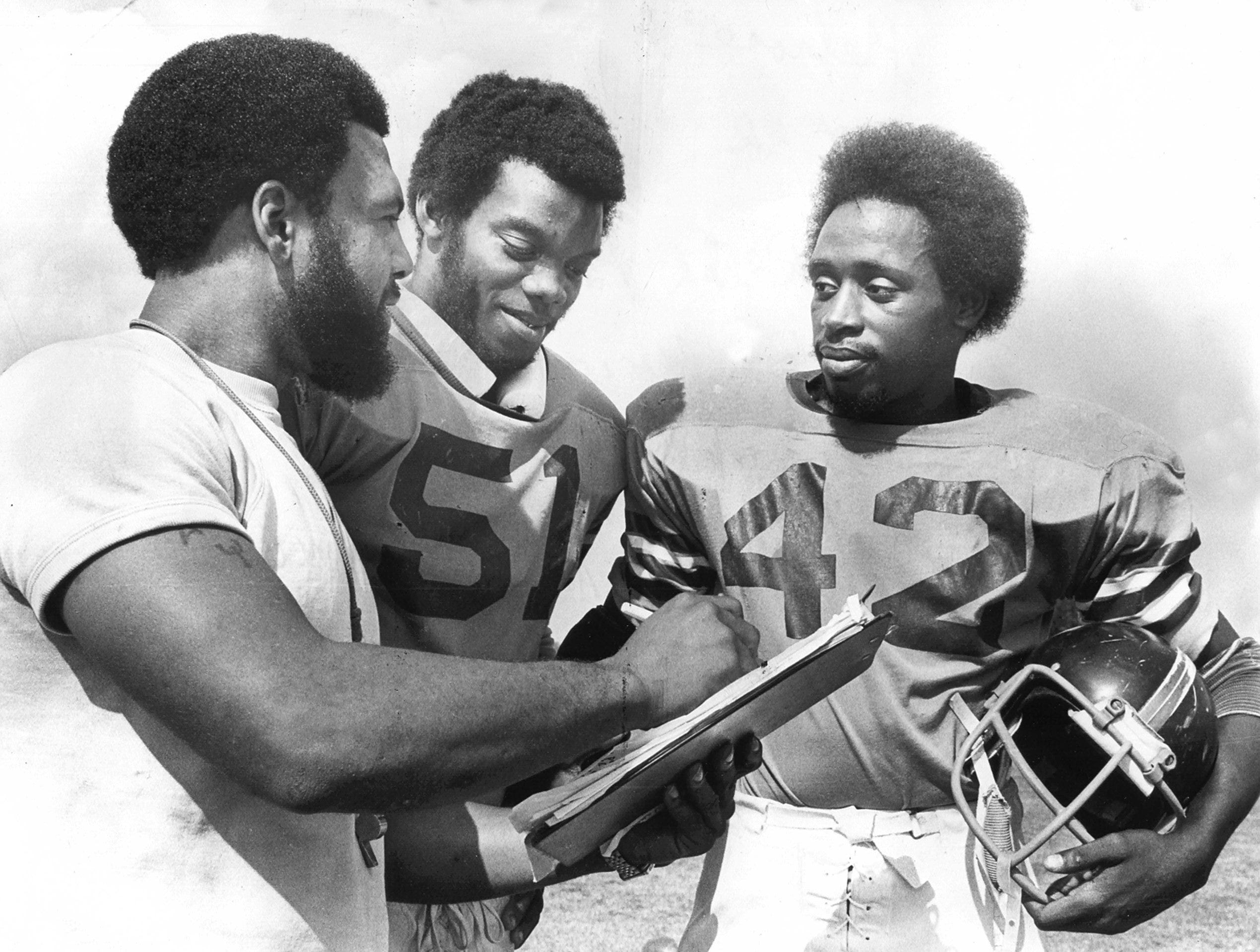 The subject was football when Melrose coach Ralph Patterson (Left) got together with Stanley Wright (Center) and James Stewart in October 1975.