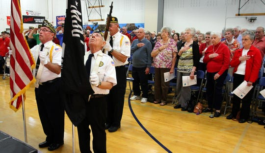 Members of American Legion Post 382 post the colors to begin the Veteran's Day presentation at the Menomonee Falls Community Education and Recreation Center in 2015. Veterans will once again gather at the center this year to commemorate the holiday.