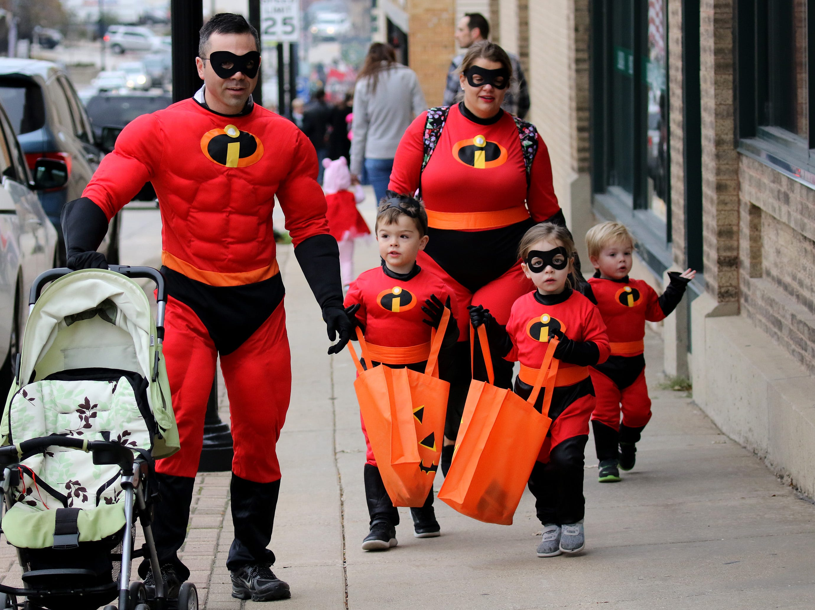 Beau and Casey Becker brought out their Incredibles Leo, Lucy and Miles for the Menomonee Falls Downtown Trick or Treating on Oct. 25.