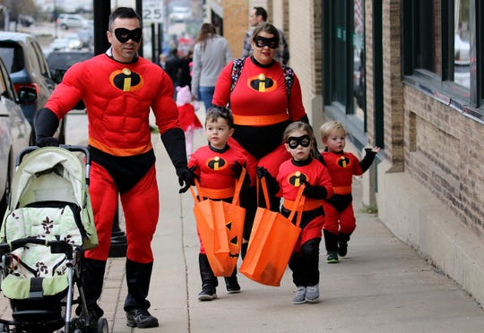 Beau and Casey Becker brought out their Incredibles Leo, Lucy and Miles for the Menomonee Falls Downtown Trick or Treating on Oct. 25, 2018.