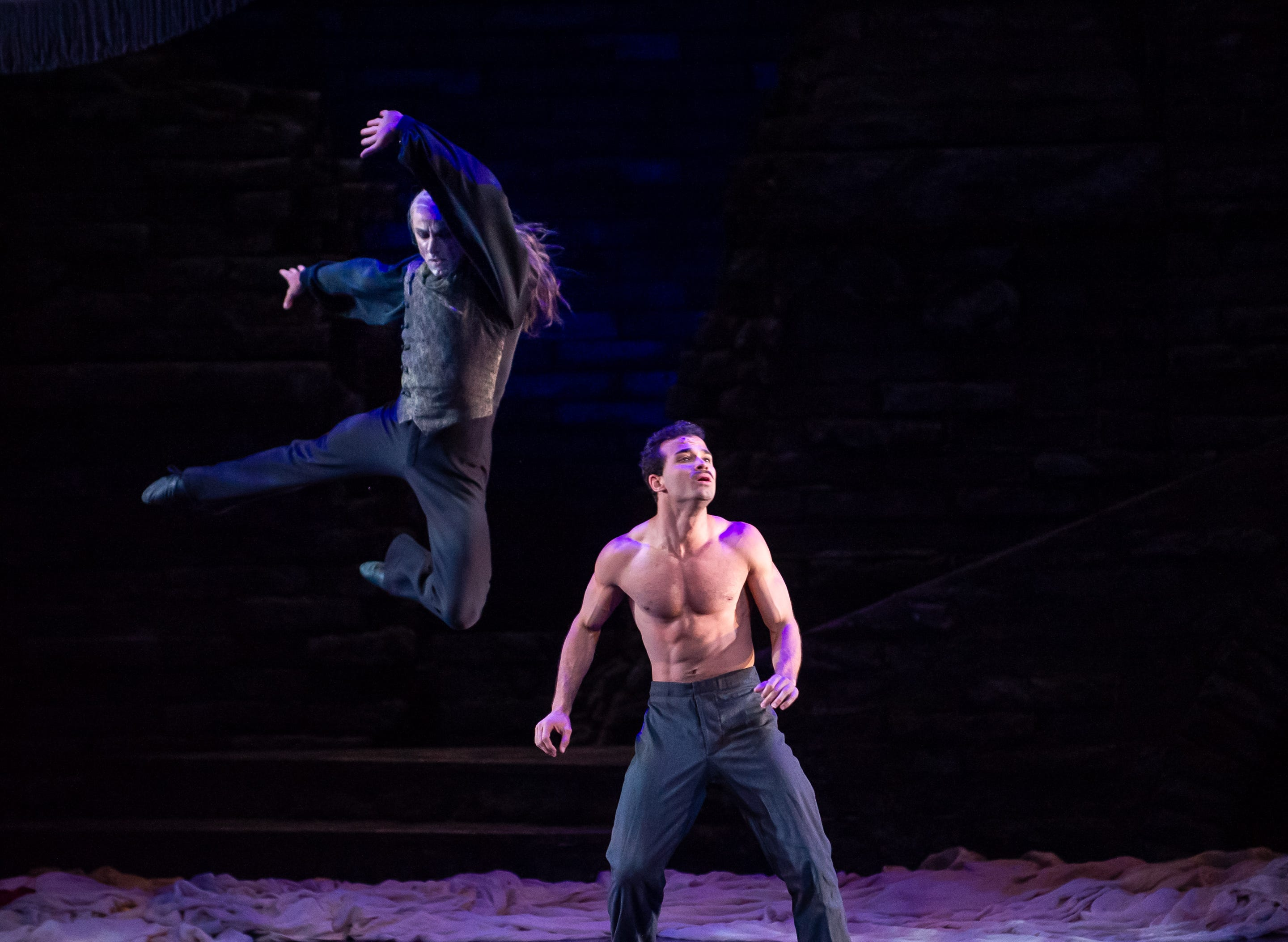 "Davit Hovhannisyan (airborne) and Randy Crespo perform in Milwaukee Ballet's ""Dracula."""