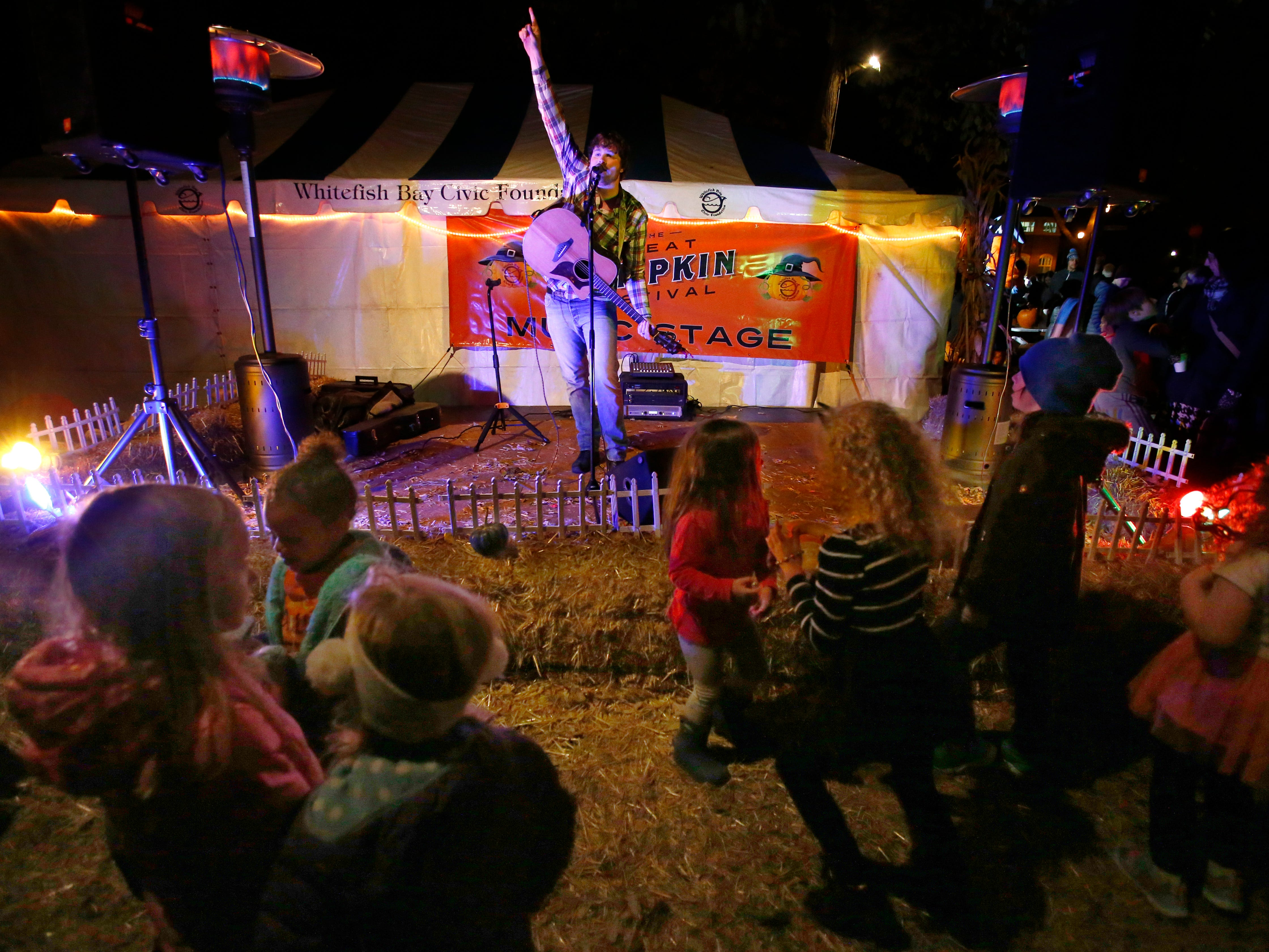 Musician Jay Matthes gets families dancing at the 32nd annual Whitefish Bay Great Pumpkin Festival at Old Schoolhouse Park, hosted by the Whitefish Bay Civic Foundation, on Oct. 25. The festival runs from 6 to 9 p.m. Wednesday, Oct. 24, through Sunday, Oct. 28.