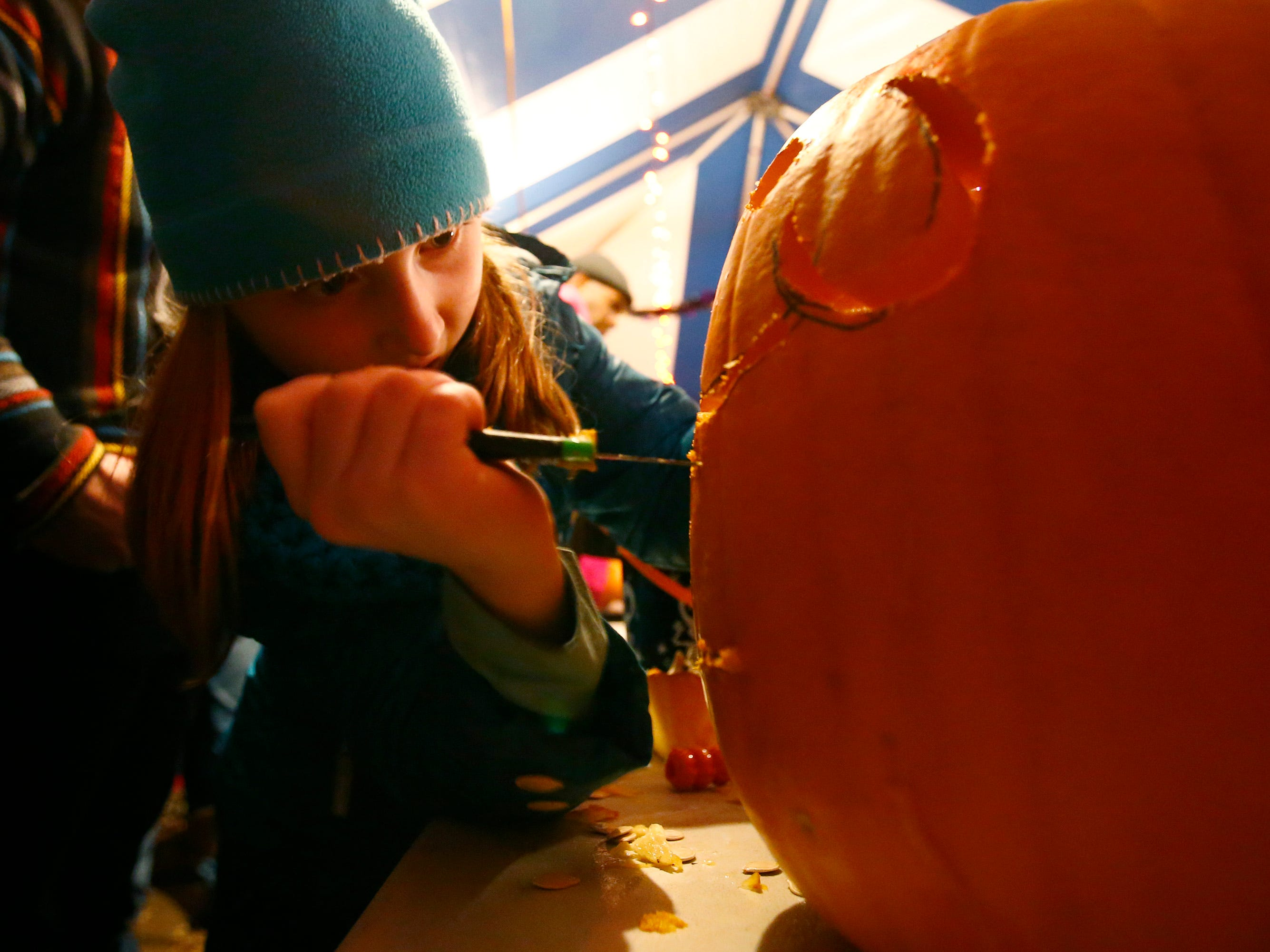 Emmalee Bauer of Wausau carves a pumpkin at the 32nd annual Whitefish Bay Great Pumpkin Festival at Old Schoolhouse Park, hosted by the Whitefish Bay Civic Foundation, on Oct. 25. The festival runs from 6 to 9 p.m. Wednesday, Oct. 24, through Sunday, Oct. 28.