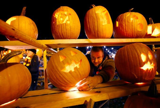 Volunteer Dave Deblitz places another completed gourd in the 32nd annual Whitefish Bay Great Pumpkin Festival display at Old Schoolhouse Park, hosted by the Whitefish Bay Civic Foundation, on Oct. 25. The festival runs from 6 to 9 p.m. Wednesday, Oct. 24, through Sunday, Oct. 28.