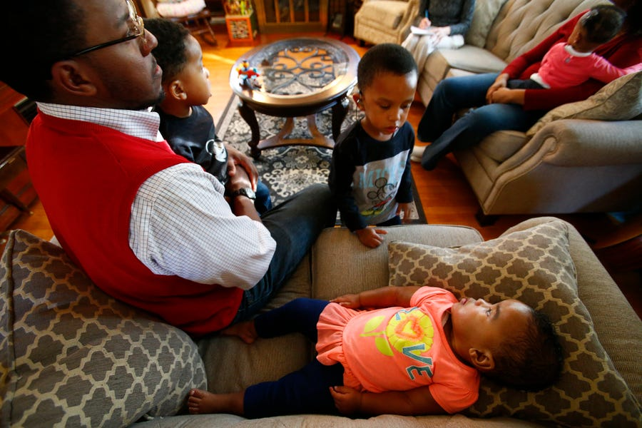 Sister Sophie Finner wakes up to twin brothers Daniel and Aiden and their father Daniel Finner in the family's Milwaukee home.