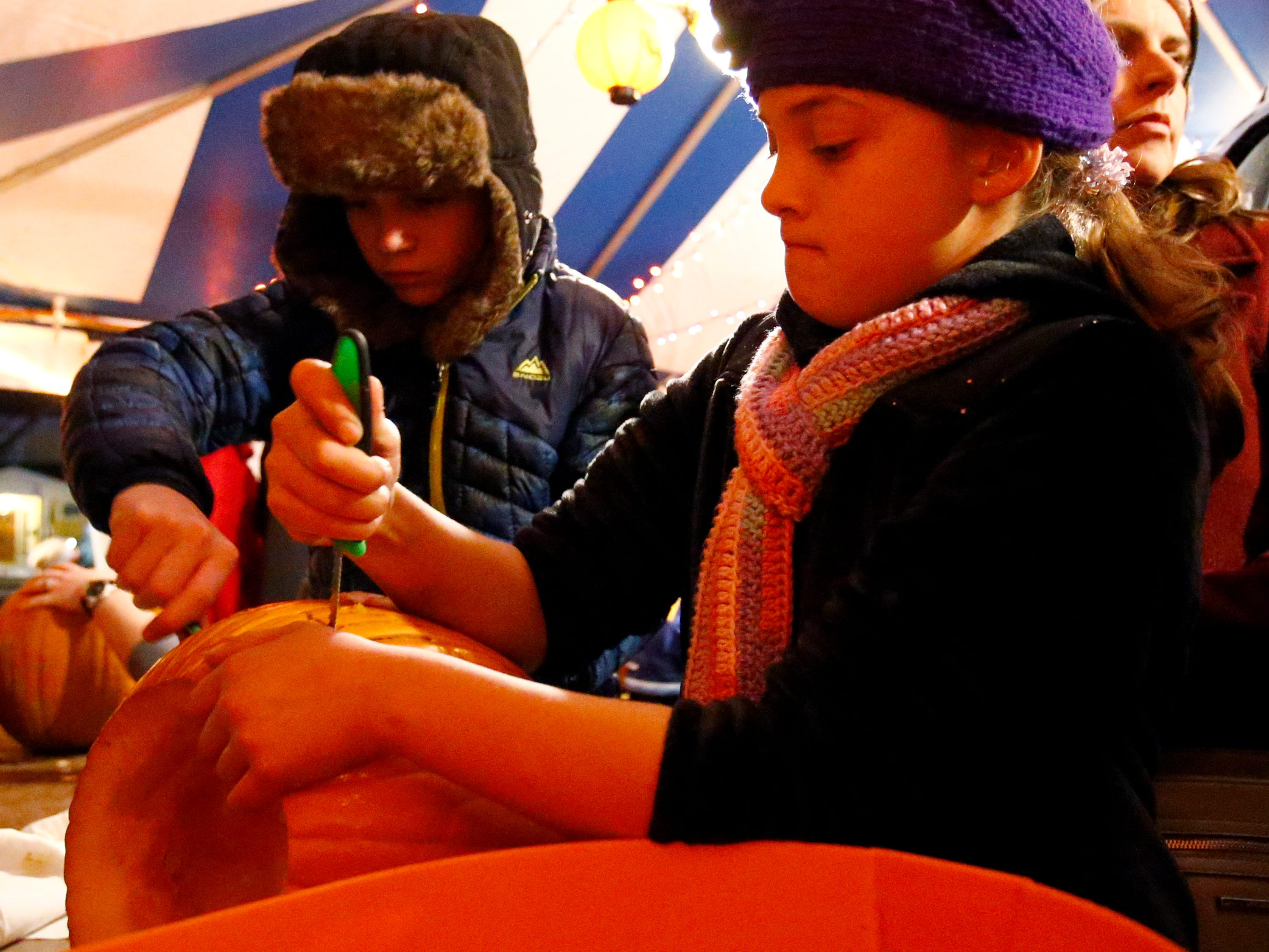 Audrey (front) and George Schroeder of Germantown team up to carve a pumpkin at the 32nd annual Whitefish Bay Great Pumpkin Festival at Old Schoolhouse Park, hosted by the Whitefish Bay Civic Foundation, on Oct. 25. The festival runs from 6 to 9 p.m. Wednesday, Oct. 24, through Sunday, Oct. 28.