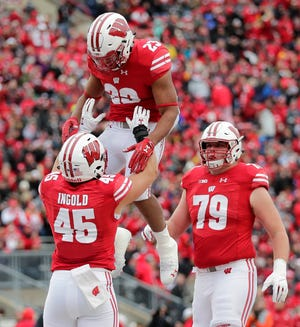 UW tailback Jonathan Taylor (23) and the rest of the Badgers' rushing offense should be able to have a good day against Northwestern's run defense.